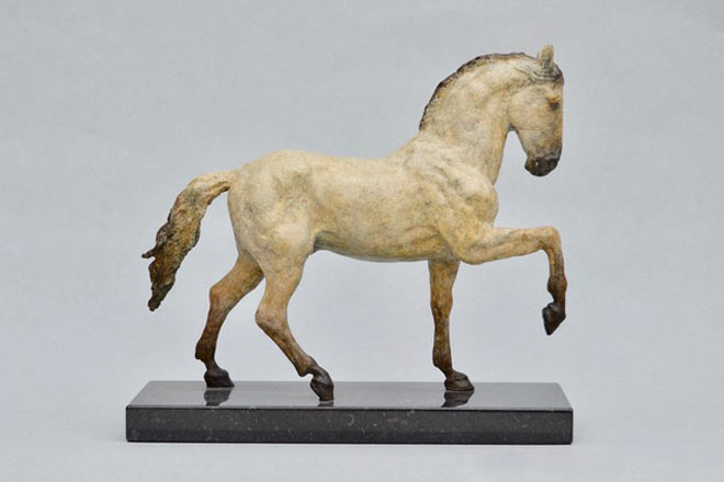 Spanish Horse Stepping : A sculpture in patinated foundry bronze by Kate Woodlock