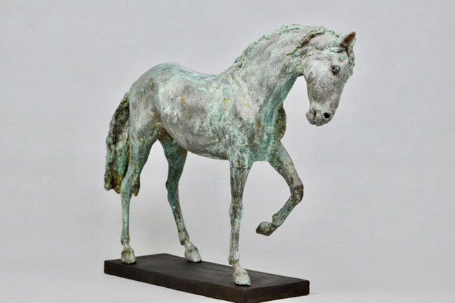 Spanish Horse Walking : A sculpture in patinated foundry bronze by Kate Woodlock